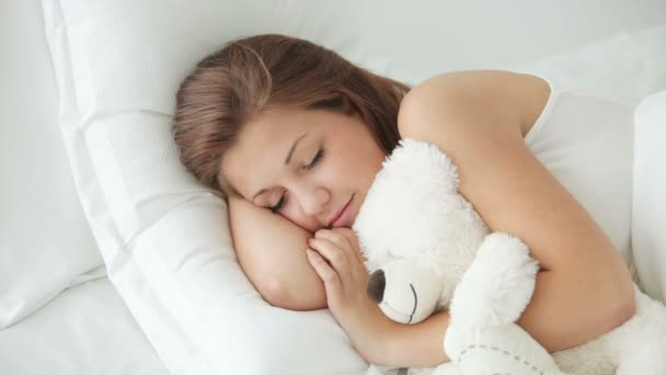 woman sleeping with teddy bear
