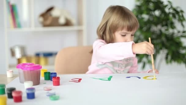 Girl painting  letters