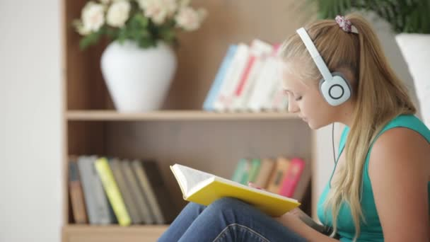 girl reading book and listening music