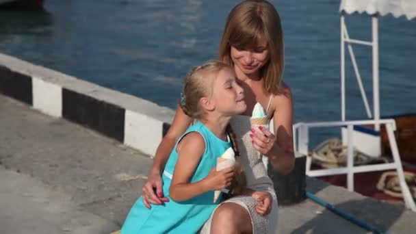 Mother and daughter eating ice creams.