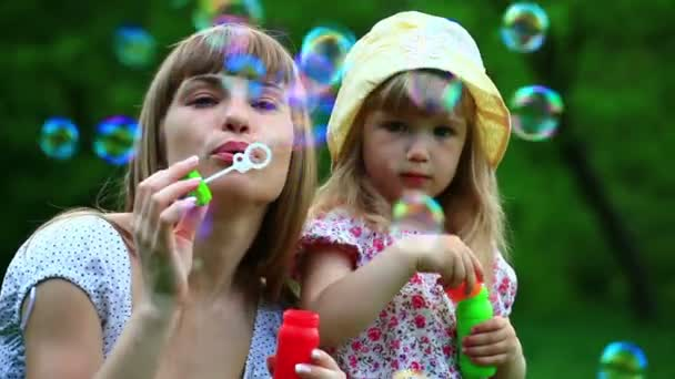 Mother and child  blowing  bubbles