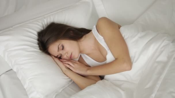 Charming young woman sleeping in bed