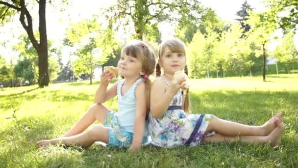 Children eating ice creams.