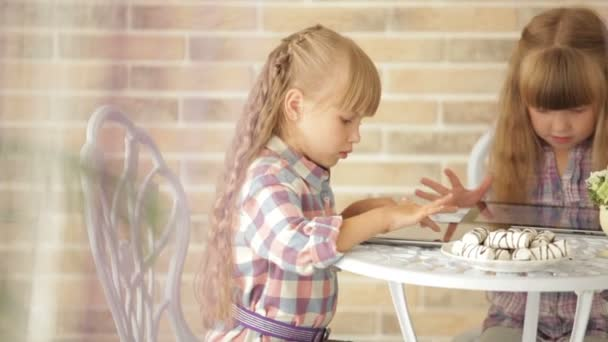 Two little girls using touchpads