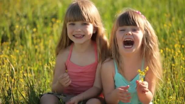 Children sitting in field