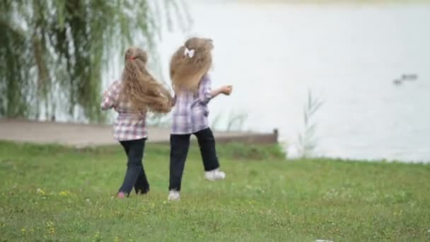 Two little girls at park running