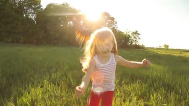 Pretty girl running on grass