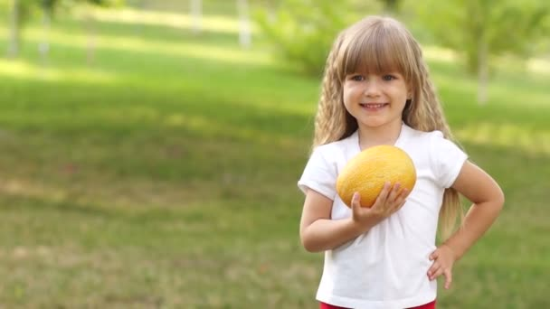 Girl holding melon