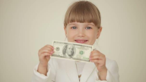 Little girl holding banknote