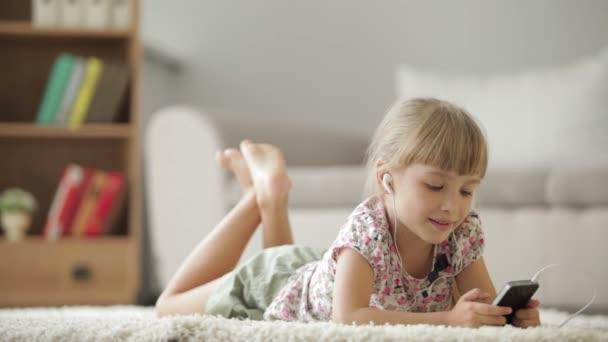 girl lying on floor listening to music