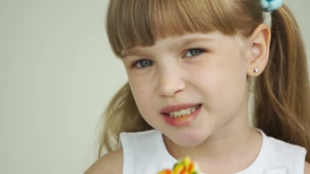 Girl with a lollipop smiling