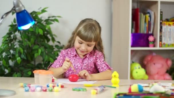 Girl coloring Easter egg