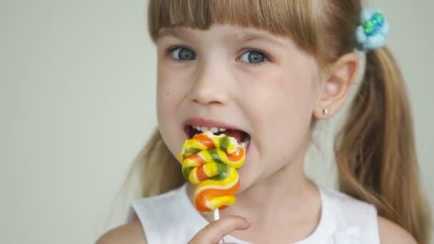 Girl biting a lollipop