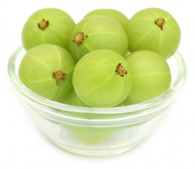 Amla fruits in a glass bowl