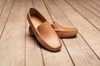 Men's Loafer Shoe on old wood background stock vector