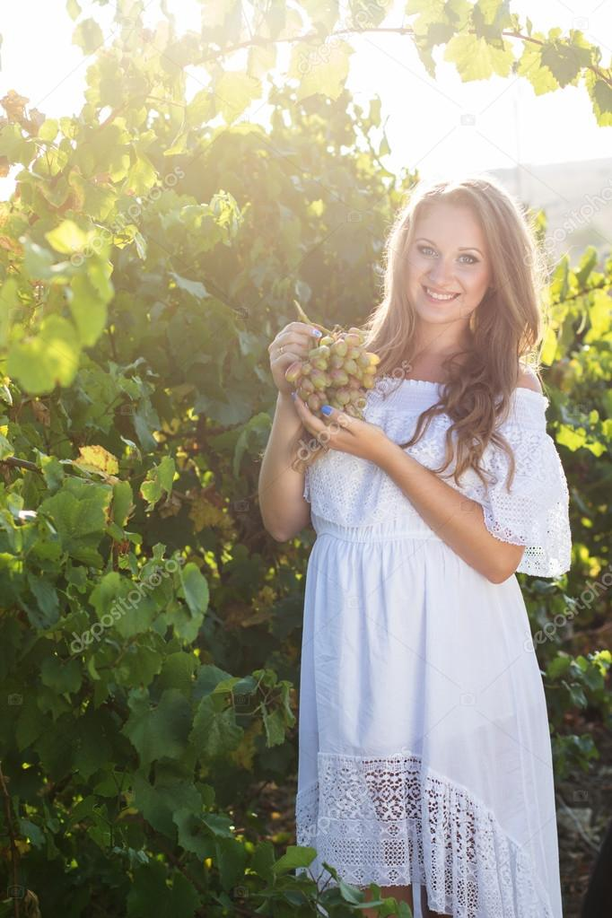 Portrait Of Young Beautiful Woman Holding Grapes Stock