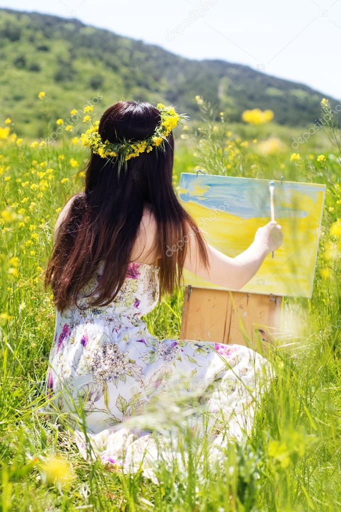 Painter woman is create picture outdoors