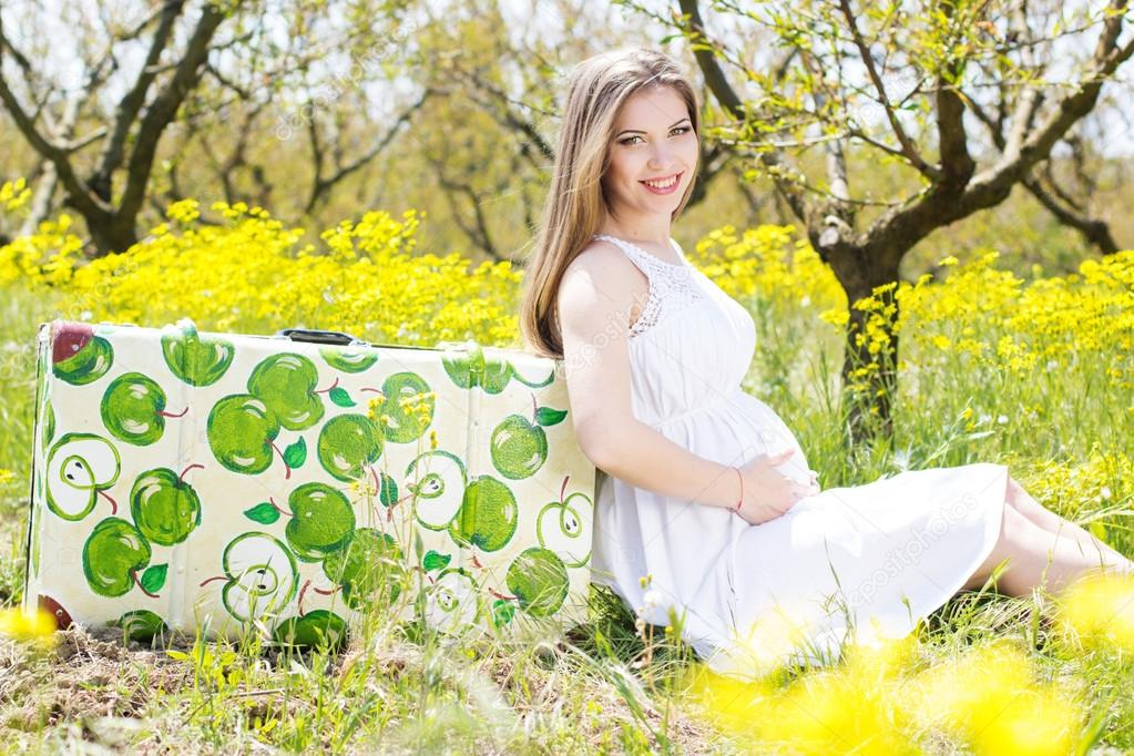 Happy pregnant woman on nature