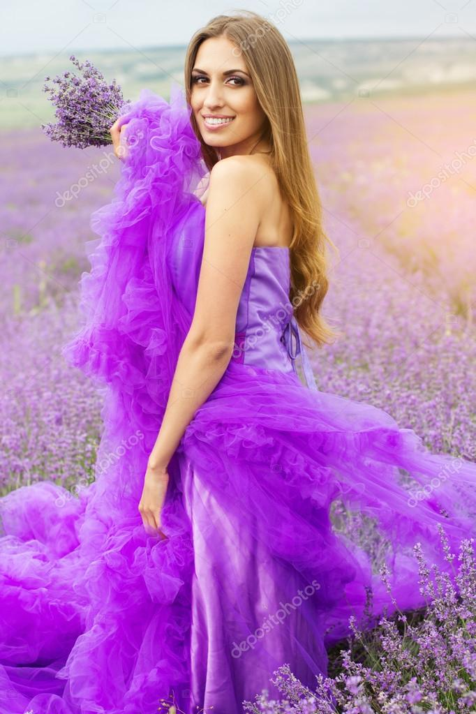 Beautiful girl is wearing fashion dress at field of lavender