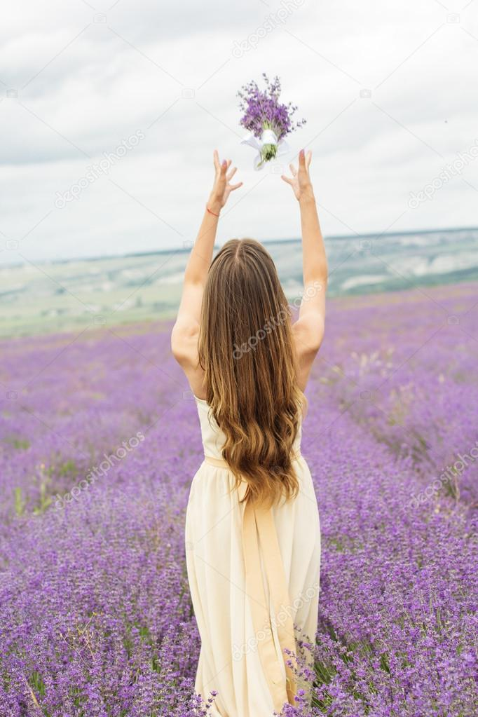 Back view of girl at purple lavender field