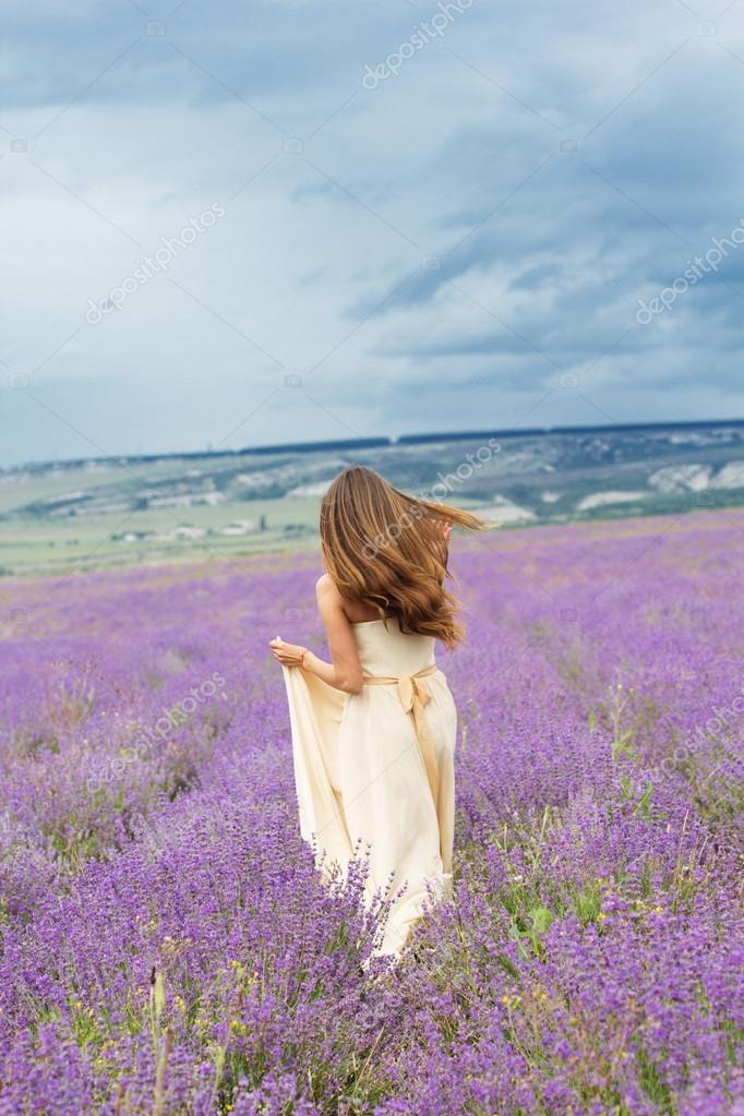 Bride girl is running at lavender field