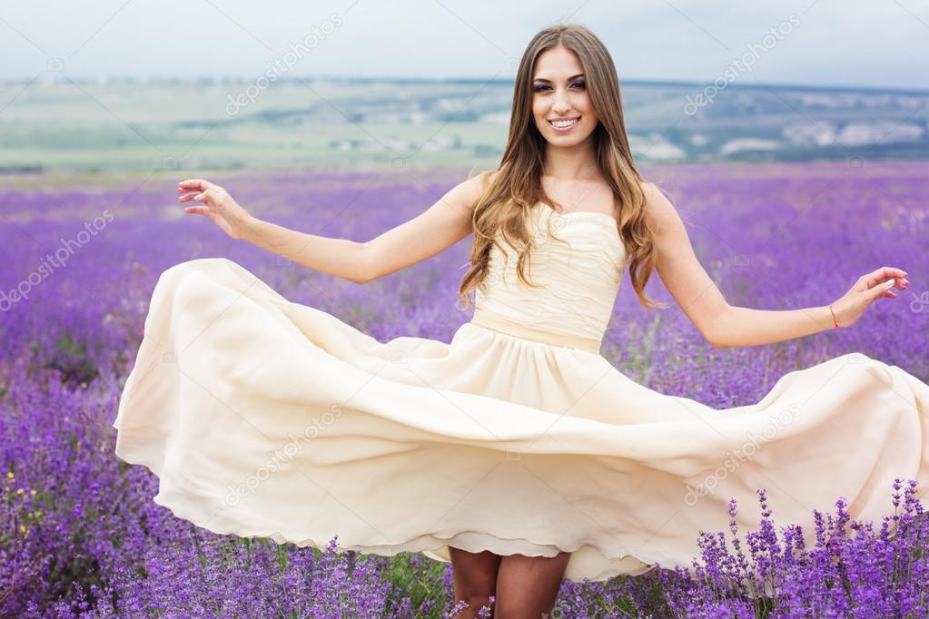 Portrait of bride girl with flying hair at lavender field