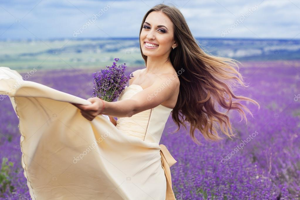 Portrait of smiling girl with flying hair at lavender field