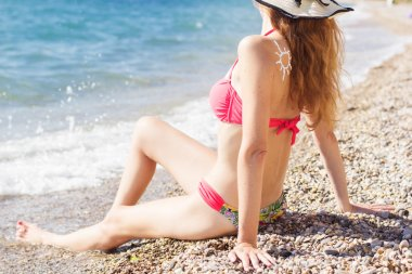 Sunscreen lotion over tan woman back with birthmarks