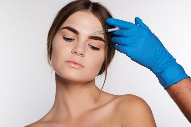 Injection to correct wrinkles on girls face