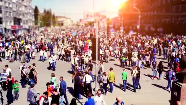 Russia, Novosibirsk, 9 may 2015. Crowd of people walking on the street on sunshine background. 3840x2160. 4k