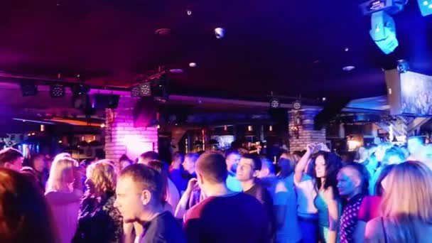 Russia, Novosibirsk, 11 september 2015. Crowd of people celebrating and partying in slowmotion in the night club. 1920x1080