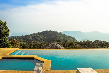 Swimming pool near the sea on mountains Koh Samui
