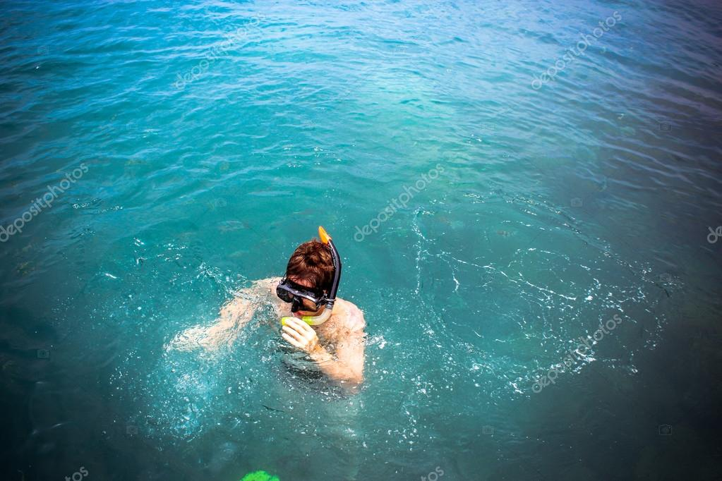 top view of a Man snorkeling in the sea
