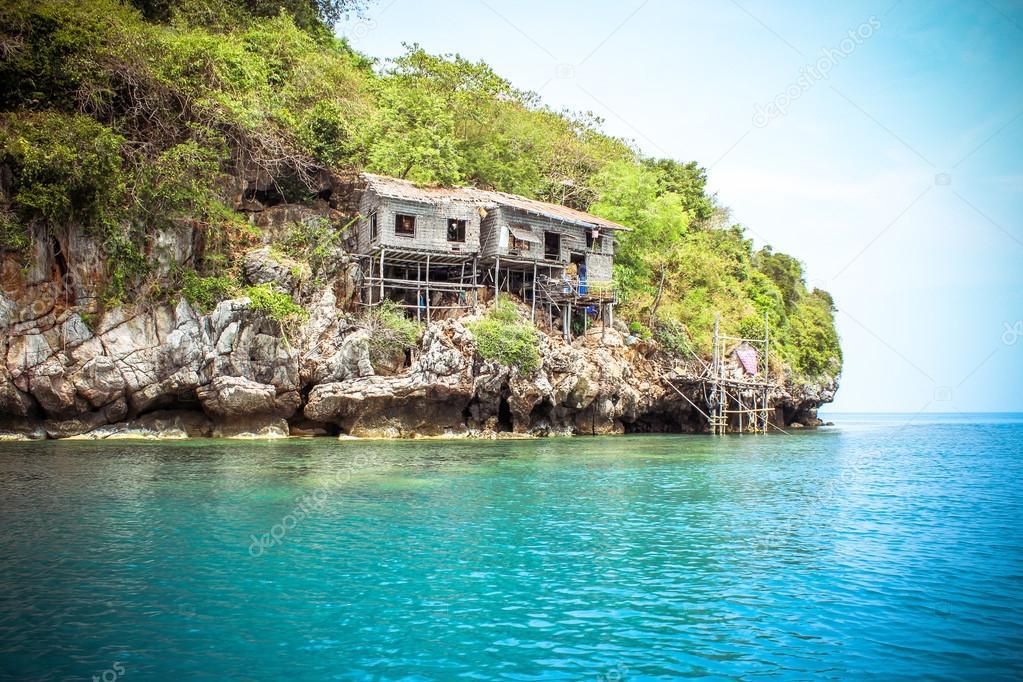 Hut on a limestone cliff in the Andaman Sea