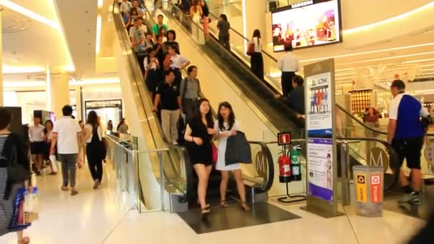 Thailand, Bangkok, 1 August 2014. Escalators of the Siam Paragon shopping center with people. Hd. 1920x1080