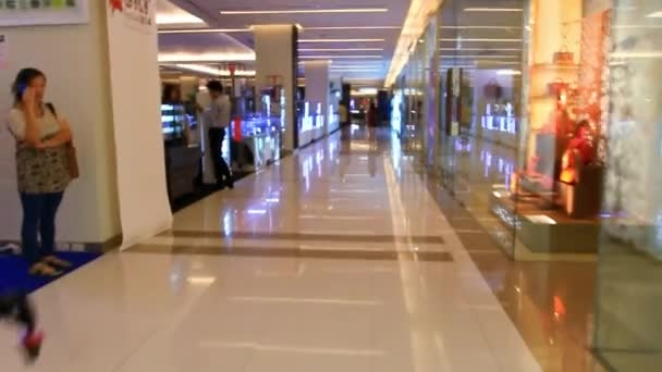 Thailand, Bangkok, 1 August 2014. Unidentified people walking in Siam Paragon Mall. HD. 1920x1080
