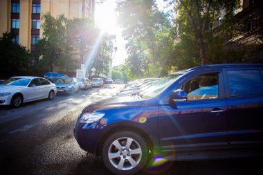 RUSSIA, 8 AUGUST 2014, Photo of parking cars in Moscow city and sunlight