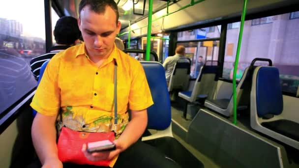 man touching texting on his smartphone in a bus. HD. 1920x1080