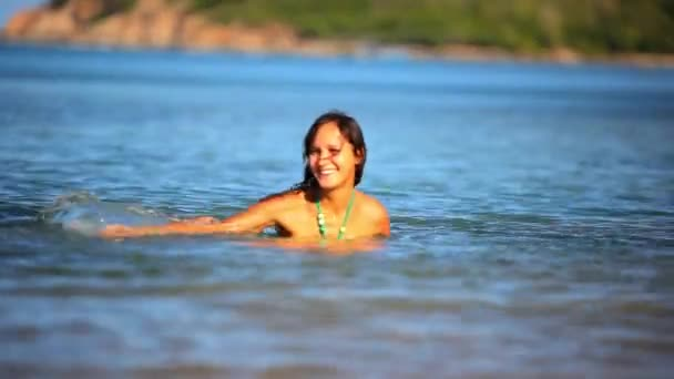 Cheerful brunette young woman in the sea water splashes. Koh Samui Thailand Video