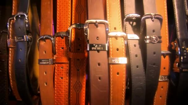 many mens leather belts for sale at flea market. HD. 1920x1080