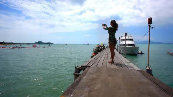 Woman take a picture from bridge of nature on the island Koh Samui. Bophut beach