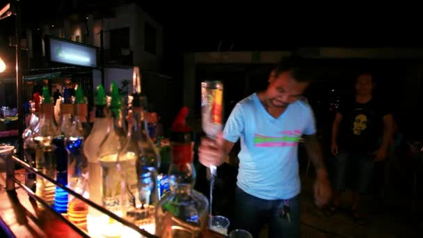 Koh Samui. Thailand. 2014 july 18. Barman to do a cocktail and making impressive move in night street. HD. 1920x1080