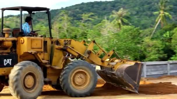 Earthmover dozer doing earthmoving works outdoors. Video