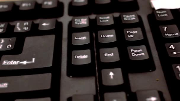 close up of a black keyboard english and thai alphabet. Macro video shift motion