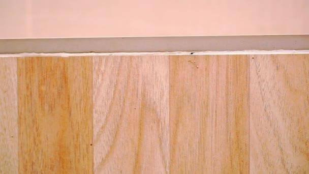 Close up van eiken parket van beige kleur macroo video shift