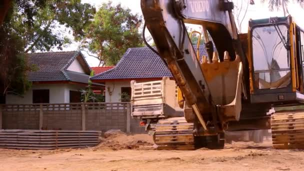 Excavator rides in construction site quarry. Video shift motion