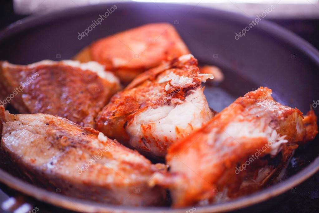 Frying fish steaks in  pan