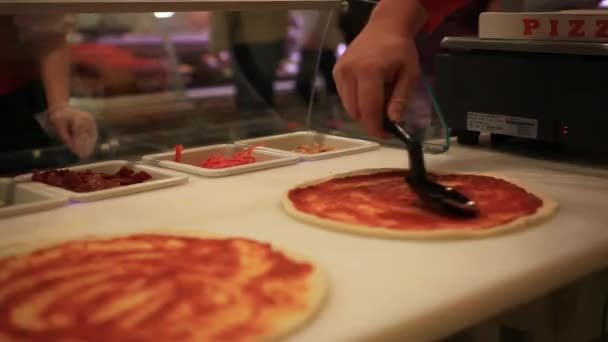 Fresh original Italian raw pizza, dough preparation in traditional style. Applying a tomato sauce. HD. 1920x1080