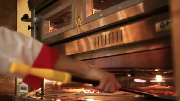chefs Hands Ready pizza getting from oven. Close up. HD. 1920x1080