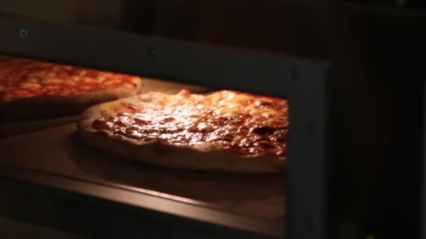 Ready pizza getting from oven and close Oven.
